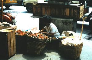 Street Vendor in Bangkok, Thailand, selling Rambutan.  Photo by Sue Jimenez