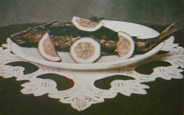 OK, so it's cooked and nicely adorned with citrus slices and laying resplendent on a white porcelain plate, with a hand-made doily underneath, but when you come right down to it, it's still just a big, dead fish (and an ugly one, at that)