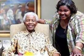 """Nelson Mandela with the family's chef and author of """"Ukutya Kwasekhaya"""", Xoliswa Ndoyiya."""