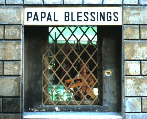 Window of a shop on the avenue leading to the Basilica of St. Peter's, The Vatican.  A little bit incongruous, what?  Photo by Sue Jimenez