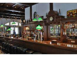 "The Long Bar in Raffles Hotel, where the Ngiam Tong Boon originated the ""Singapore Sling"" sometime around 1910 - 1915.  Photo Credit:  worldsbestbars.com"