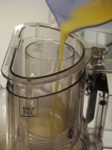 """After whisking the """"wet"""" mix ingredients, with the food processor on dough, slowly pour the wet mix into the food processor"""
