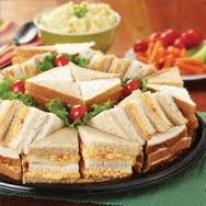 This is the way my Mom served us sandwiches.  Small, not too much filling and cut into triangles, neatly arranged.  Ah, those were gentler times.  (Photo Credit:  www.pinterest.com)