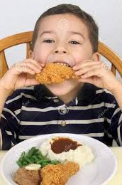 Fortunately, this child is eating fried chicken the legal way (Photo Credit:  www.dreamstime.com)