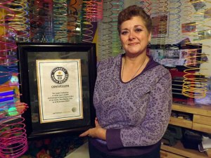 Susan Suazo, current Guinness World Record Holder for largest collection of Slinkys (photo courtesy of Albuquerque Journal)