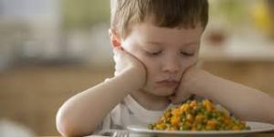 Could this child be colour blind and sees the vegetables as an unappetizing pink? (Photo Credit:  www.huffingpost.com)