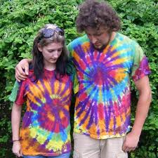 Tie dye'd T-shirt fad from the 1970's (these people are HIP!) (Photo Credit:  www.madebyhippies.com)