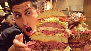 See this man disarticulating his jaws to eat this sandwich?  (Photo Credit:  www.youtube.com)