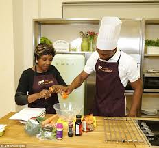 """I told you before, I'M the chef tonight!""  (Photo Credit:  www.dailymail.co.uk)"