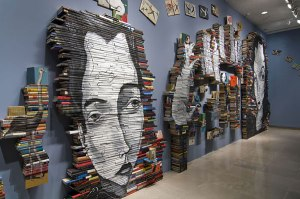 Mike Stilkey painting on about 5,000 books! (Photo Credit: www.demilked.com)