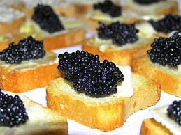 The proper way to eat caviar (don't chase it around the plate!) (Photo Credit: www.primermagazine.com)