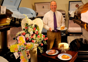 This gentleman is apparently combining two careers: funeral director and caterer! (Photo Credit: www.blog.funeralone.com)
