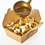 "The Canadian dish, ""poutine"" probably had the White House Chefs scrambling (Photo Credit: www.torontolife.com)"