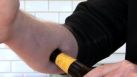 Forgot the bottle opener? Just use your brains (or your forearm!) Photo Credit: www.lifehacker.com)