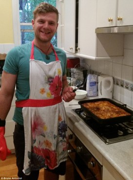 """I'm not sure if the cooking that's relaxing or wearing this lovely apron"" (Photo Credit: www.dailymail.co.uk)"