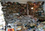 This is hoarding. I do not hoard. My cookbook collection is neat and not dangerous at all (unless a bookcase should tip over) (Photo Credit: www.c2cbigruel.com)