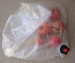 Put about 5 or 6 small pomegranates into the wine bag. Seal it any way you can.