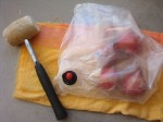 Place the bag on an old towel to absorb the blows and prevent the bag from becoming damaged. Pound away!