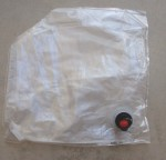 Cut off one corner of the wine bag, large enough to insert a few small pomegranates